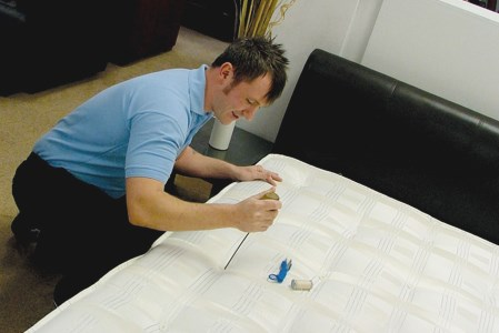 Technician is in the process of repairing the bed