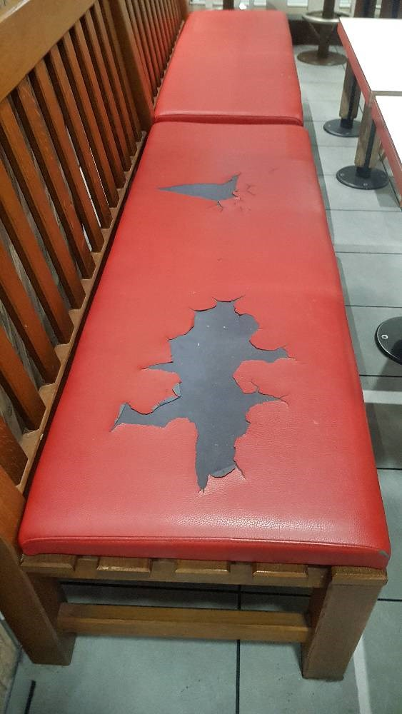 Before photo of a red leather bench