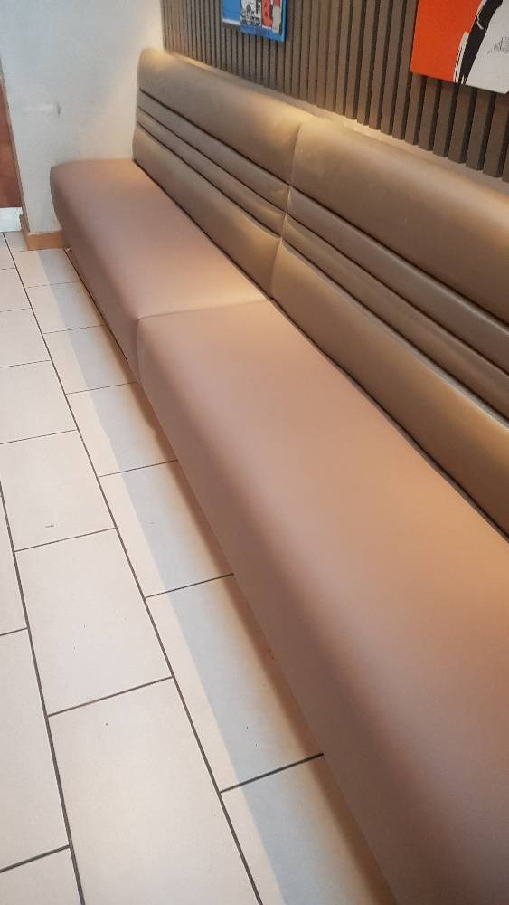 After photo of a cream leather bench