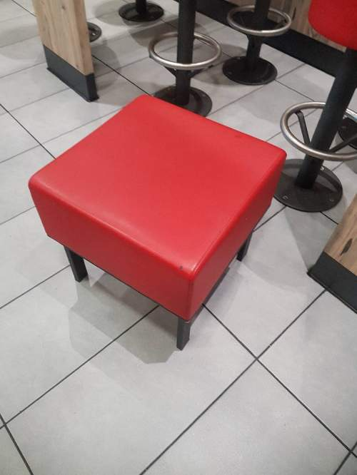 The re-upholstery of a restaurant stool