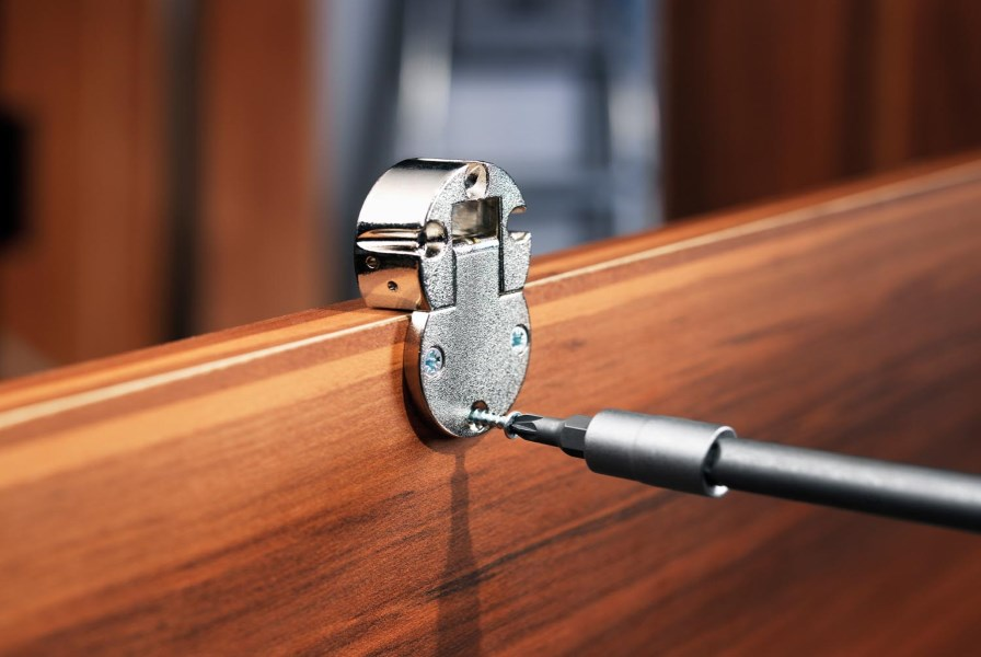 The replacement of a hinge on a wooden cabinet