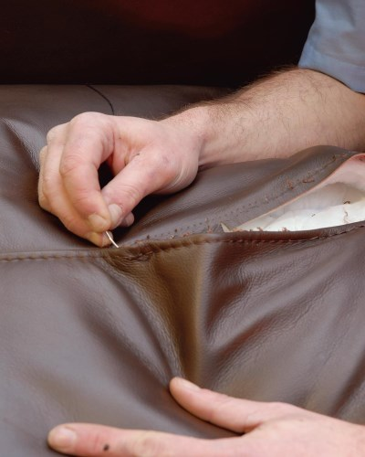 Re-stitching of a leather seat cushion