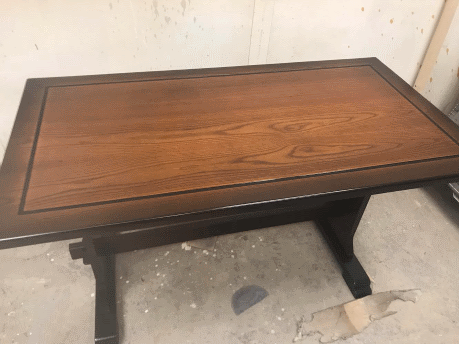 Picture of the wooden table after being fully restored